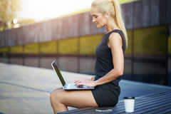 Busy woman working outside Royalty Free Stock Photos