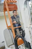 Busy worker driving forklift Royalty Free Stock Photo