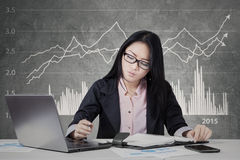 Busy worker with financial statistic background Royalty Free Stock Images