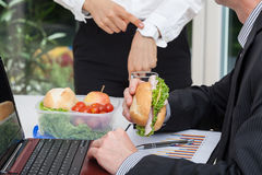 Busy worker with his angry boss Stock Photography
