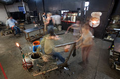 Busy Workers in Glass Workshop Stock Images