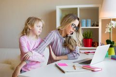 Busy working mother doesn`t have time for her kid. Busy mom concept stock photo