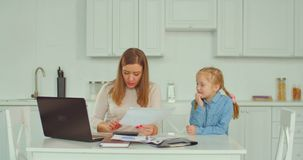 Busy working mother doesn`t have time for her kid stock footage