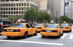 Busy yellow taxis in traffic, New York City royalty free stock photography