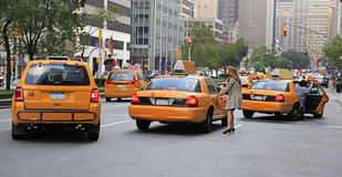 Busy yellow taxis in traffic, New York City Stock Photography
