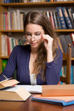 Busy young brunette student Royalty Free Stock Photo