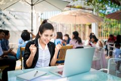 Busy young business woman working on desk stock images
