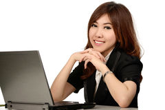 Busy young business woman working at desk typing on a laptop Stock Images