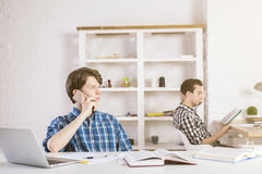 Busy young businessmen royalty free stock photo