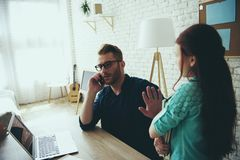 Busy young father refuses to help daughter royalty free stock photo