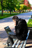 Man With Laptop At The Park Royalty Free Stock Photography