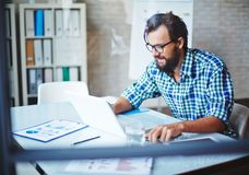 Busy young man Stock Photography