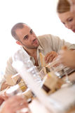 Busy young people eating lunch at work Royalty Free Stock Image