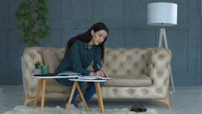 Busy young woman doing domestic accounting at home stock footage