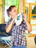 Busy Young woman ironing clothes. Stock Photos