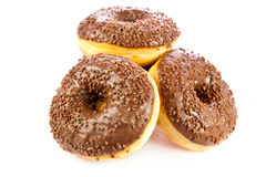 Butées toriques d'isolement sur la nourriture blanche de boulangerie de beignets de la pâte de fond Photographie stock libre de droits