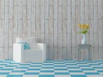 Butaca con la almohada y las flores en el taburete, tejas azules Foto de archivo libre de regalías