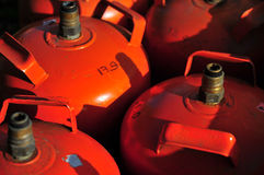 Butane cylinders. Old orange butane or propane cylinders Stock Photo