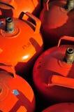 Butane cylinders. Old orange butane or propane cylinders Stock Photos
