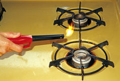 Butane lighter and propane stove Royalty Free Stock Photography