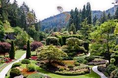 butchart Kanada arbeta i trädgården ön vancouver arkivbild
