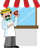 Butcher. A butcher standing in front of his shop window Stock Photos