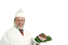 Butcher. Holding a roast beef on a tray royalty free stock image