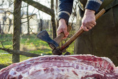 Butcher chopping meat Royalty Free Stock Image
