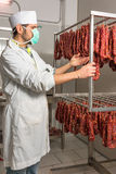 Butcher controls sausage Royalty Free Stock Images