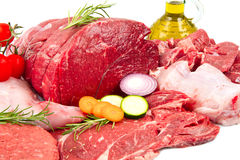 Butcher cut meat assortment garnished. Fresh butcher cut meat assortment garnished royalty free stock image