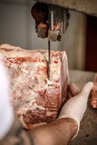 Butcher is cutting meat Royalty Free Stock Images