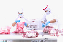 Butcher cutting meat on the table Royalty Free Stock Photo