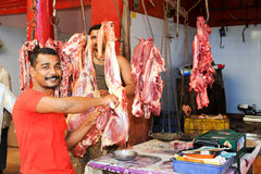 Butcher cutting mutton meat on his shop at Kollam Stock Photos