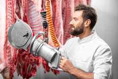 Butcher cutting pork at the manufacturing royalty free stock photography