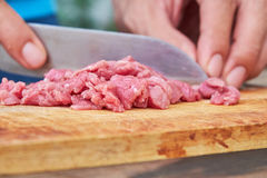 Butcher cutting pork meat. On kitchen Royalty Free Stock Photo