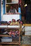Butcher and his stall at the market in India Royalty Free Stock Photos