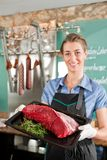 Butcher Holding Beef Served on Tray Royalty Free Stock Photo