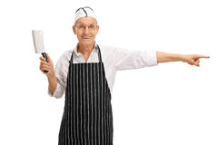 Butcher holding a cleaver and pointing Stock Photography