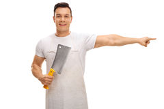 Butcher holding a cleaver and pointing right Royalty Free Stock Image