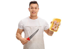 Butcher holding a knife and chicken drums Stock Photo