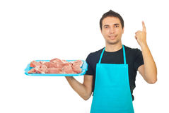 Butcher holding meat and pointing up Stock Photography