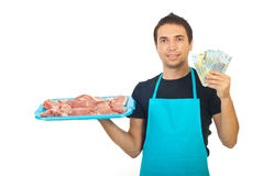 Butcher holding money Royalty Free Stock Image
