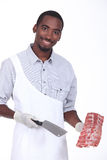 Butcher holding ribs Stock Photo