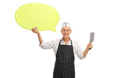 Butcher holding speech bubble and cleaver Royalty Free Stock Photos