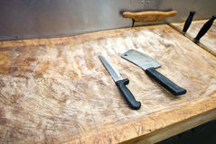 Butcher knife on cutting board in supermarket Stock Images