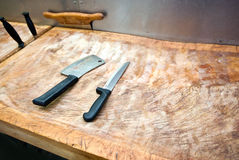 Butcher knife on cutting board in supermarket Royalty Free Stock Images
