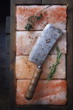 Butcher knife on pink salt and spices Stock Photos