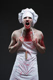 Butcher man. aggressive maniac chef in the blood Royalty Free Stock Photo