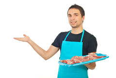 Butcher man making presentation Royalty Free Stock Photos