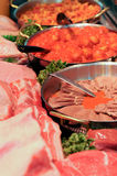 Butcher meat. Butcher prepared meat dished with sauce royalty free stock image